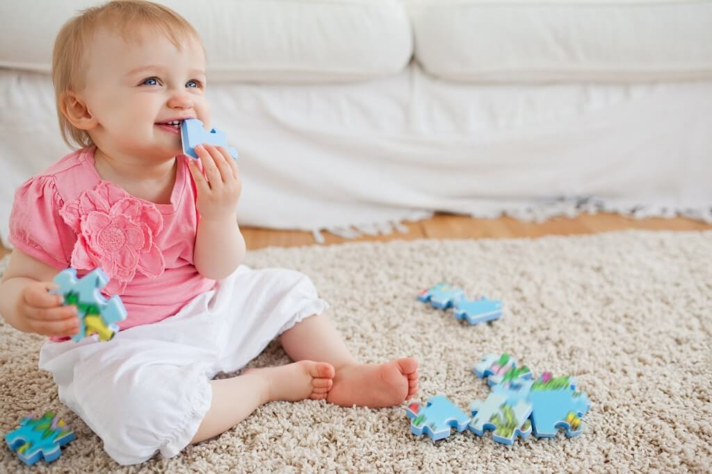 bigstock-Blond-Baby-Playing-With-Puzzle-214060941