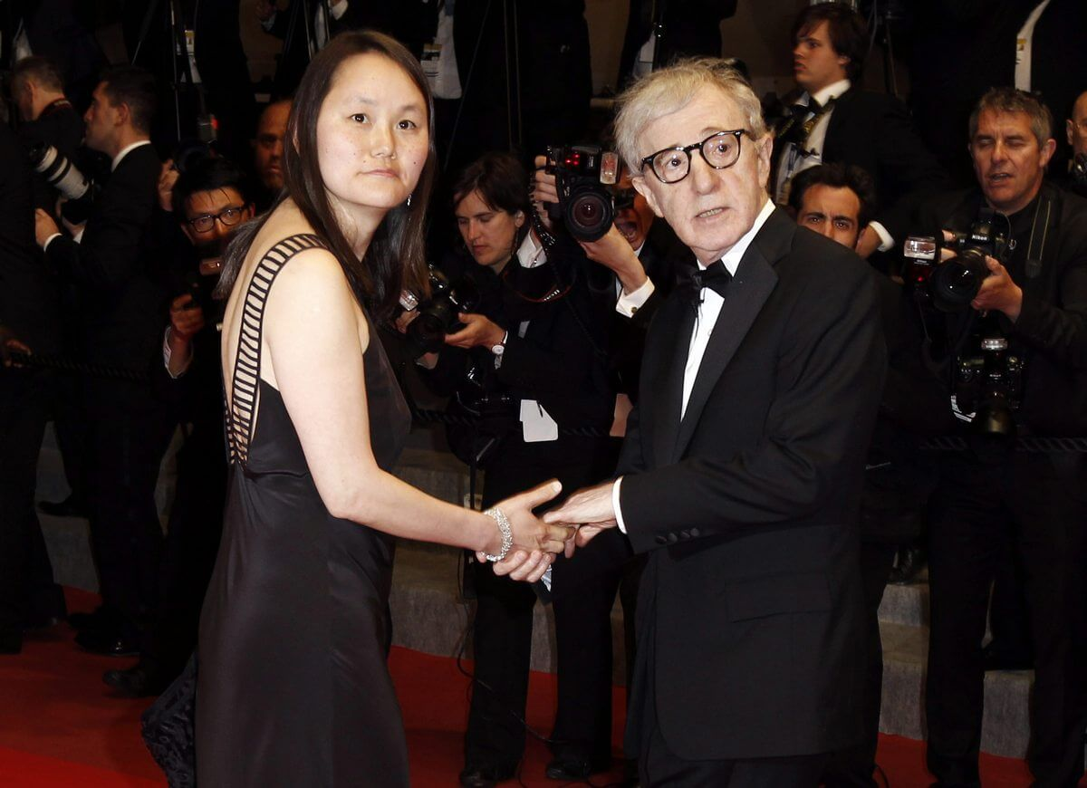 "Filmmaker Woody Allen, right, and Soon-Yi Previn arrive for the premiere of ""Another Year"", at the 63rd international film festival, in Cannes, southern France, Saturday, May 15, 2010. (AP Photo/Matt Sayles)"